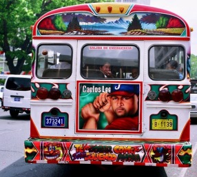 The Red Devils of Panama Panama City has a very unique Private/Public transportation system. The system is known by the nickname of the buses. The Diablo Rojos aka The Red Devils. They get their name by the red and white paint that the buses are adorned with. The Diablo Rojos are former school buses from the USA that were imported because of the cheap price and endless use the bus drivers put them through on the dusty highways of Panama. The Diablo Rojos have quite an infamous reputation. The bus drivers race from stop to stop to get the fares waiting patiently. Panamanians will wait for a bus that is painted the coolest. They want to be seen in the very best looking Diablo Rojo. It is a status symbol of the Panamanian people. Who is responsible for the look of the Diablo Rojo? Well, Yoyo is the godfather of the Diablo Rojo artists. He is 82 years old and has been painting thousands of buses for more the 50 years. Andreas Salazar another painter is known quite simply as Salazar to the public. When he walks the city streets he can hear his name being called. Salazar has had many assistants who have gone on to be well known artists in the Diablo Rojo genre. In Chorrera another well known artist is Monchi. Each has their own style and protocal for how the create these master works of art and moving murals. Each bus has a driver and a Pavo. The pavo collects the fare and alerts the passengers as to the route the bus is taking. The Panamanian Government is trying to replace the Diablo Rojo with a street car system and proponents of the Diablo Rojo are afraid a culture and a way of life will forever disappear with these old american school buses.