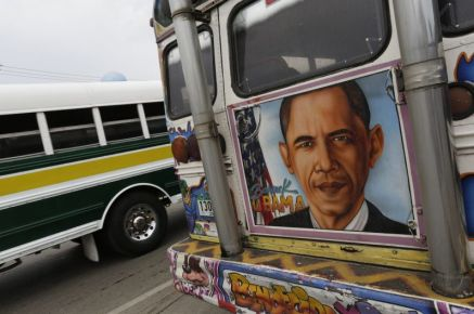 """REFILE - CORRECTING TYPO Graffiti including a portrait of U.S President Barack Obama is seen on the back of a bus known as Diablo Rojo in Panama City September 12, 2014. According to the bus drivers, the second-hand U.S Bluebird school buses, known as Diablos Rojos, or """"Red Devils"""" are part of the public transport culture. The buses are decorated with graffiti of images of religious icons, sports idols, politicians and celebrities as a symbol of admiration, respect or just to make people smile. According to local media, with the new transport system of the Metro Bus and the new Metro subway the traditional Red Devils are now disappearing and only used for few specific routes in and around Panama. Picture taken on September 12, 2014. REUTERS/Carlos Jasso (PANAMA - Tags: SOCIETY TRANSPORT POLITICS)"""
