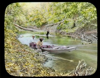 Cana_Creek,_Seth_Meek_(maybe)_and_other_man_in_canoe_on_river._1912._(3607563743)