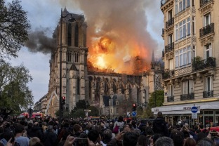 Firefighters battle to extinguish a giant fire that engulfed the Notre Dame Cathedral in Paris, France on April 15, 2019. A huge fire swept through the roof of the famed Notre-Dame Cathedral in the French capital, sending flames and huge clouds of grey smoke billowing into the sky. The flames and smoke plumed from the spire and roof of the gothic cathedral, visited by millions of people a year. Photo by Samuel Boivin/ABACAPRESS.COM Notre Dame de Paris Notre-Dame de Paris (monument) Flames Flame Fire Flammes Flamme Incendier Bruler Incendie Feu Blaze | 679070_001 Paris France