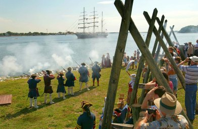 Photo courtesy WillDickey.com--06/10/04--Re-enactors fire a rifle salute to a tall ship on the St. Johns River as it passes by Fort Caroline during the Sail Jacksonville celebration June 10, 2004. (www.willdickey.com)